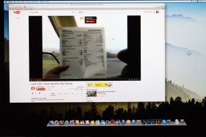 My iMac computer screen showing the YouTube application with a video playing in HD.